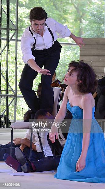 Hedydd Dylan as Helena Oliver Johnstone as Puck perform on stage during a performance of A Midsummer Night's Dream by the Royal Shakespeare Company...