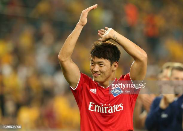 Hee Chan Hwang of Hamburg jubilates after winning the Second Bundesliga match between SG Dynamo Dresden and Hamburger SV at DDVStadion on September...