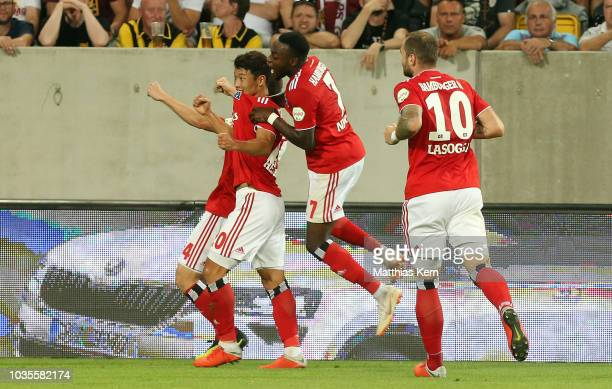 Hee Chan Hwang of Hamburg jubilates with team mates after scoring the first goal during the Second Bundesliga match between SG Dynamo Dresden and...