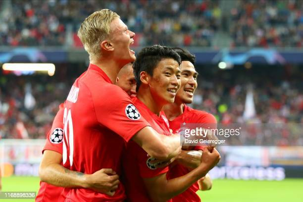 Hee Chan Hwang of Salzburg celebrates with his teammates after scoring during the UEFA Champions League match between RB Salzburg and KRC Genk at Red...