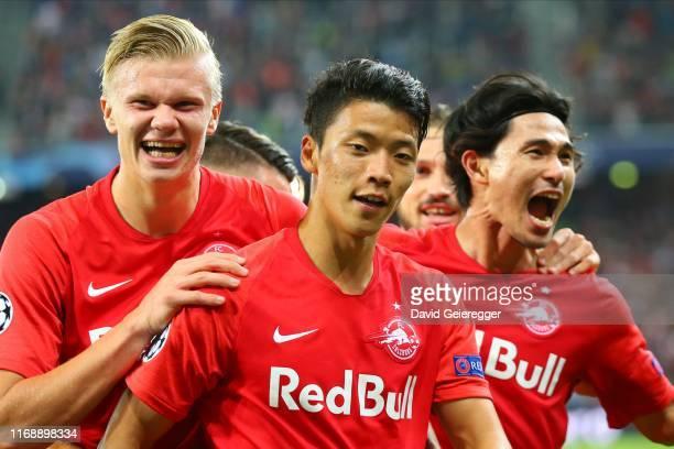 Hee Chan Hwang of Salzburg celebrates with his teammates Erling Haaland of Salzburg and Takumi Minamino of Salzburg after scoring during the UEFA...