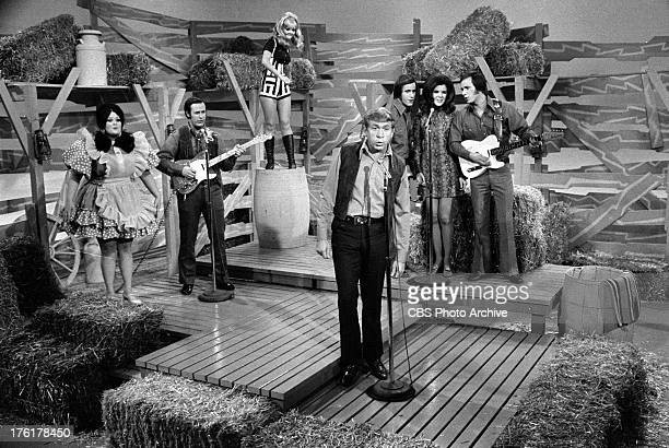 Hee Haw cast from left; Lulu Roman, Don Rich, Jeannine Riley, Buck Owens, John and Jim Hagar and Susan Raye. Image dated November 26, 1969.