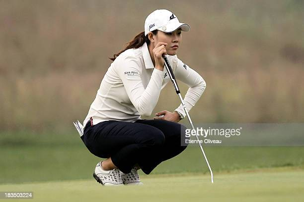 Hee Kyung Seo of South Korea llines up a putt during the final round of the Reignwood LPGA Classic at Pine Valley Golf Club on October 6 2013 in...