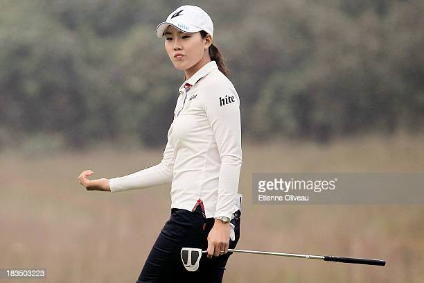 Hee Kyung Seo of South Korea reacts to a putt during the final round of the Reignwood LPGA Classic at Pine Valley Golf Club on October 6 2013 in...