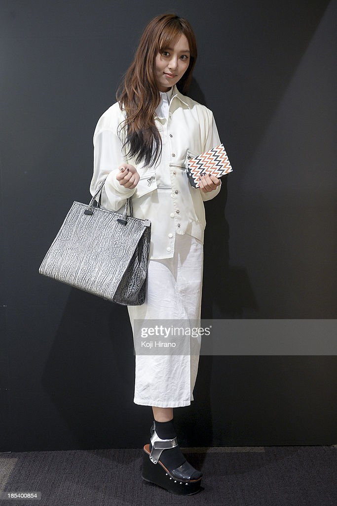 Hee Ohna wears a top and skirt by lounge and lounge, and shoes by CRY at Mercedes-Benz Fashion Week Tokyo Spring/Summer 2014 on October 14, 2013 in Tokyo, Japan.
