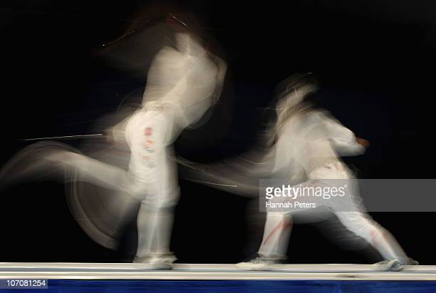 Hee Sook Jeon of South Korea competes in the Women's Team Foil against Chie Yoshizawa of Japan at Guangda Gymnasium during day ten of the 16th Asian...