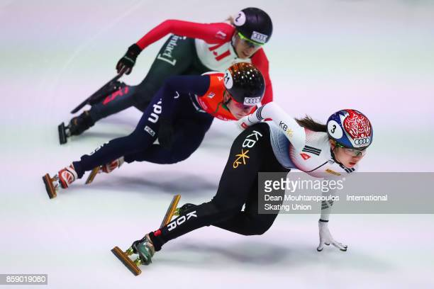 Hee Suk Shim of Korea Yara van Kerkhof of the Netherlands and Marianne StGelais of Canada compete in the 1000m Womens Semi Final during the Audi ISU...