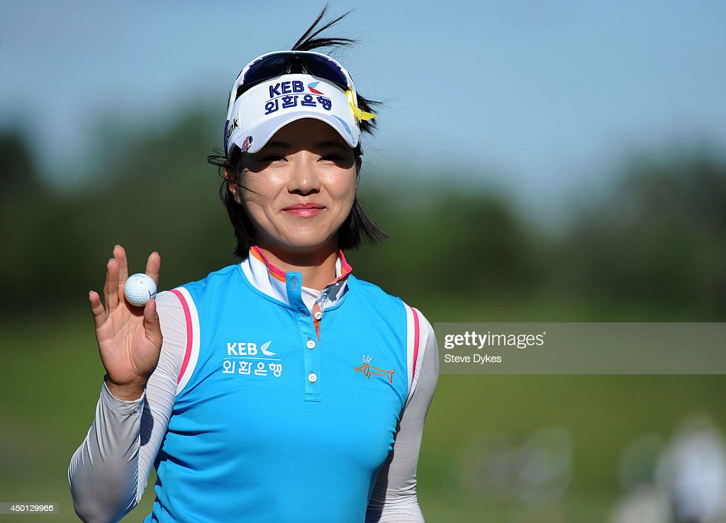 Hee Young Park, of South Korea, acknowledges the gallery as she walks off the ninth hole during the first round of the Manulife Financial LPGA Classic at the Grey Silo Golf Course on June 5, 2014 in Waterloo, Ontario, Canada.
