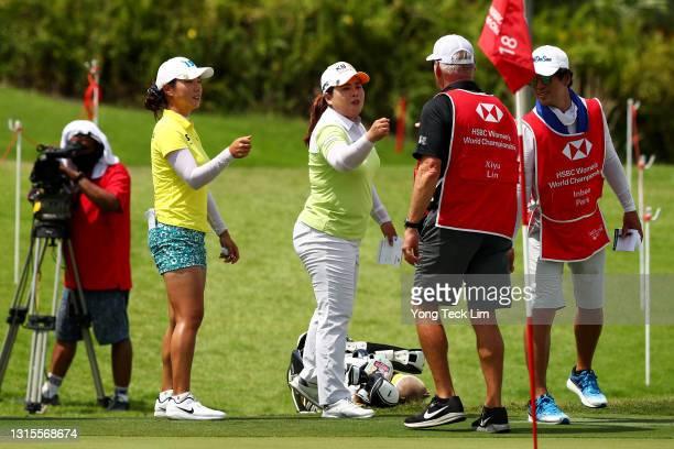 Hee Young Park of South Korea, compatriot Inbee Park and her husband and caddie Gi Hyeob Nam congratulate David Scott Poitevent, caddie of Xiyu Lin...