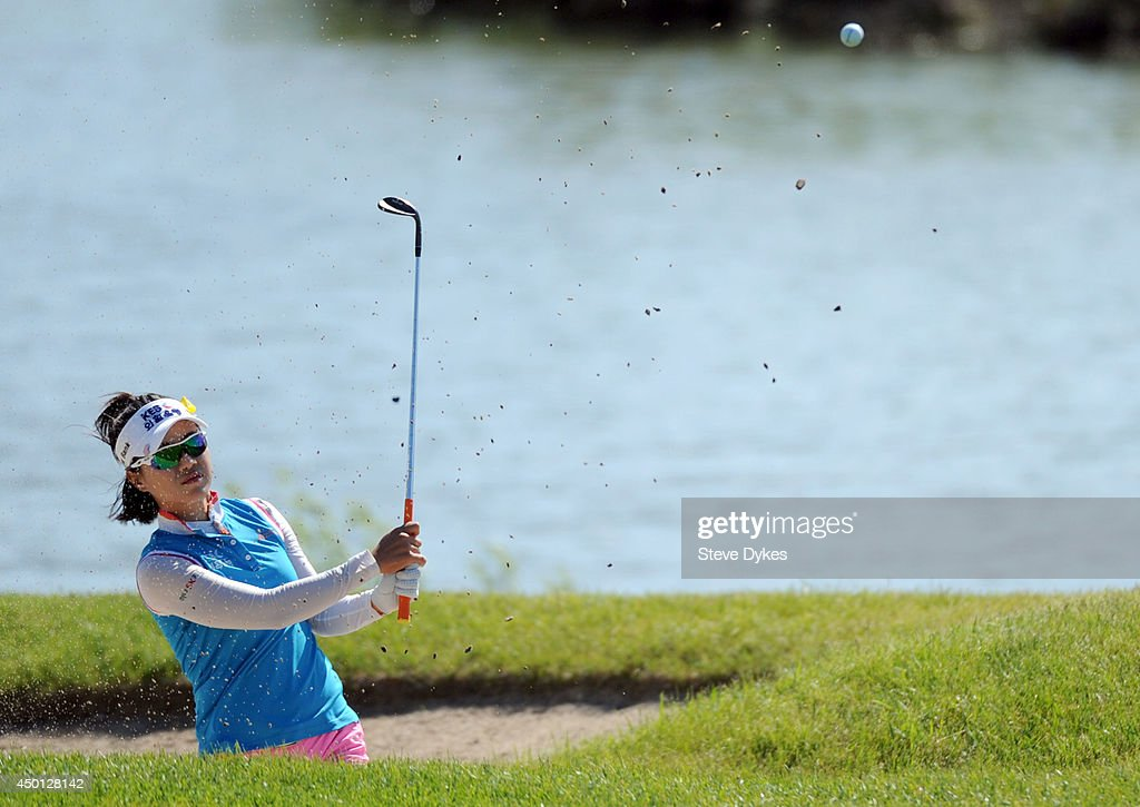 Hee Young Park of South Korea hits out of a bunker on the fifth hole during the first round of the Manulife Financial LPGA Classic at the Grey Silo Golf Course on June 5, 2014 in Waterloo, Ontario, Canada.