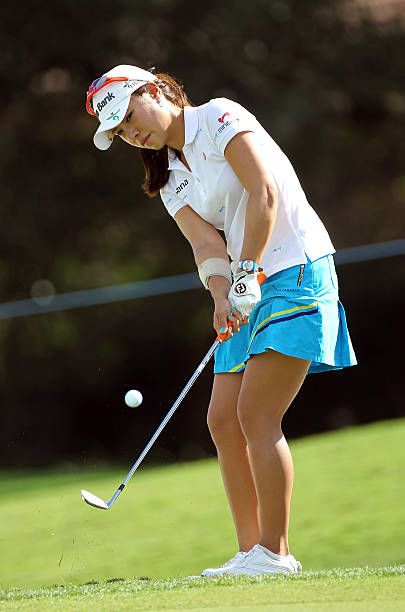 Hee Young Park of South Korea plays a shot on the 4th hole during the final round of the CME Group Titleholders at the Grand Cypress Resort on...