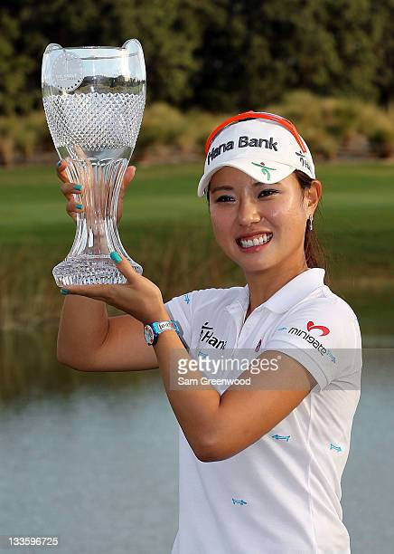 Hee Young Park of South Korea poses with the trophy after winning the CME Group Titleholders at the Grand Cypress Resort on November 20 2011 in...