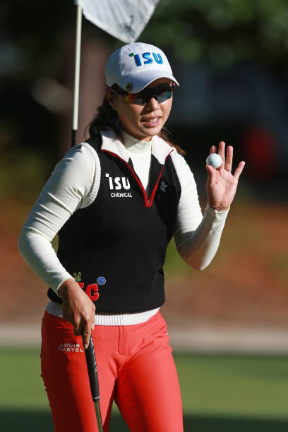 Hee Young Park of South Korea waves to the gallery on the 16th hole during the final round of the LPGA QSeries presented by Blue Cross and Blue...