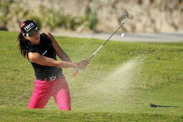 Hee Young Park of the Republic of Korea plays a shot out of a bunker on the seventh hole during round two of the Pure Silk Bahamas LPGA Classic on...