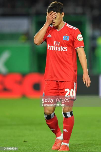 Heechan Hwang of Hamburg holds his hand in front of his face during the Second Bundesliga match between SpVgg Greuther Fuerth and Hamburger SV at...