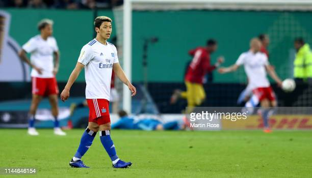 Heechan Hwang of Hamburg looks dejected during the DFB Cup semi final match between Hamburger SV and RB Leipzig at Imtech Arena on April 23 2019 in...