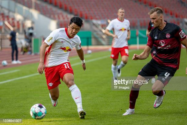 Heechan Hwang of RB Leipzig and Asger Soerensen of 1FC Nuernberg during the DFB Cup first round match between 1 FC Nuernberg and RB Leipzig at...