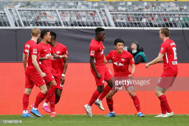 Hee-Chan Hwang of RB Leipzig celebrates his side's second goal scored by Dani Olmo of RB Leipzig during the Bundesliga match between Borussia...