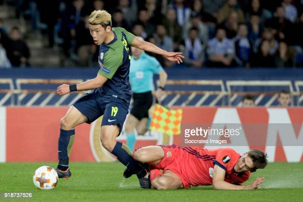 HeeChan Hwang of Red Bull Salzburg Diego Llorente of Real Sociedad during the UEFA Europa League match between Real Sociedad v Salzburg at the...