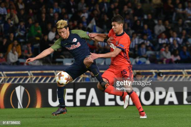 HeeChan Hwang of Red Bull Salzburg duels for the ball with Hector Moreno of Real Sociedad during the UEFA Europa League Round of 8 1st Leg match...