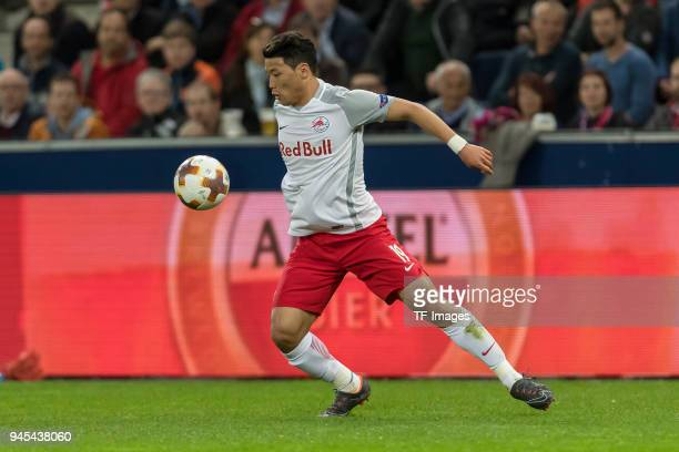 HeeChan Hwang of Salzburg controls the ball during the UEFA Europa League quarter final leg two match between RB Salzburg and Lazio Roma at Red Bull...