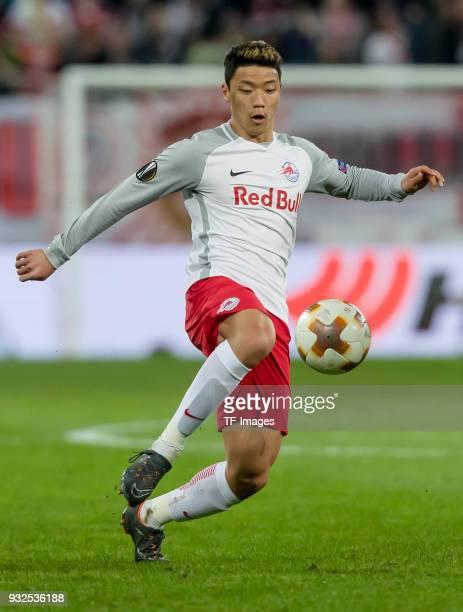 HeeChan Hwang of Salzburg controls the ball during UEFA Europa League Round of 16 second leg match between FC Red Bull Salzburg and Borussia Dortmund...