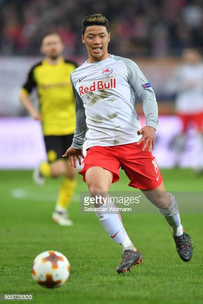 HeeChan Hwang of Salzburg runs after the ball during the UEFA Europa League Round of 16 2nd leg match between FC Red Bull Salzburg and Borussia...