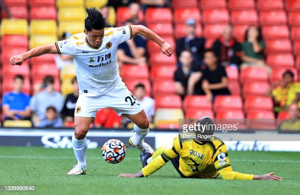 Hee-Chan Hwang of Wolverhampton Wanderers goes past Danny Rose during the Premier League match between Watford and Wolverhampton Wanderers at...