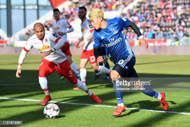 Heechan Hwangof Hamburg and Jann George of Regensburg compete for the ball during the Second Bundesliga match between SSV Jahn Regensburg and...