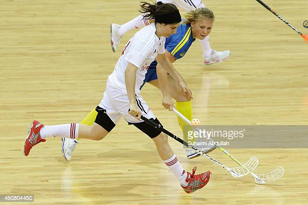 HeedArvidsson Rebecca of Sweden and Fabienne Riner of Switzerland challenge for the ball during the World University Championship Floorball match...