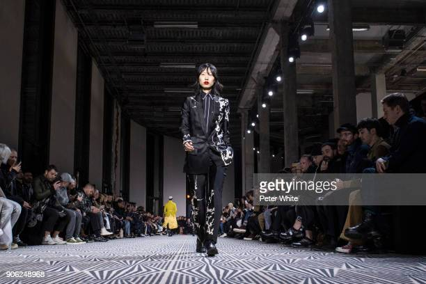 Heejung Park walks the runway during the Haider Ackermann Menswear Fall/Winter 20182019 show as part of Paris Fashion Week on January 17 2018 in...