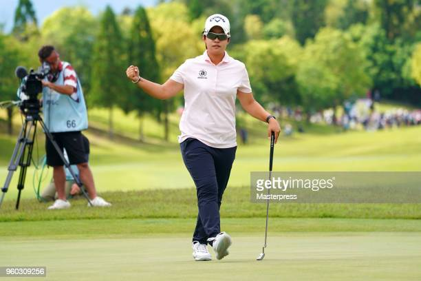 Hee-Kyung Bae of South Korea celebrates after a winning putt on the 18th green during the Chukyo TV Bridgestone Ladies Open at Chukyo Golf Club...