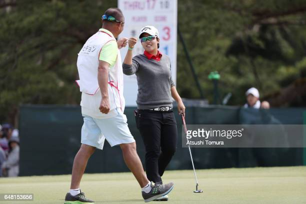 HeeKyung Bae of South Korea celebrates after making her birdie putt on the 18th green during the final round of the Daikin Orchid Ladies Golf...
