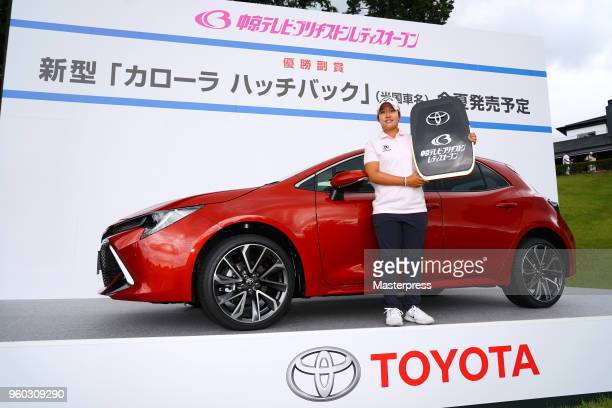 Hee-Kyung Bae of South Korea poses with the prize car after winning the Chukyo TV Bridgestone Ladies Open at Chukyo Golf Club Ishino Course on May...