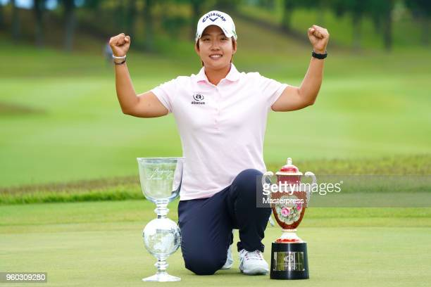 Hee-Kyung Bae of South Korea poses with the trophy after winning the Chukyo TV Bridgestone Ladies Open at Chukyo Golf Club Ishino Course on May 20,...