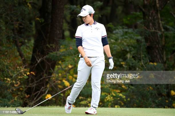Hee-Kyung Bae of South Korea throws her driver after her tee shot on the 4th hole during the final round of the LPGA Tour Championship Ricoh Cup at...