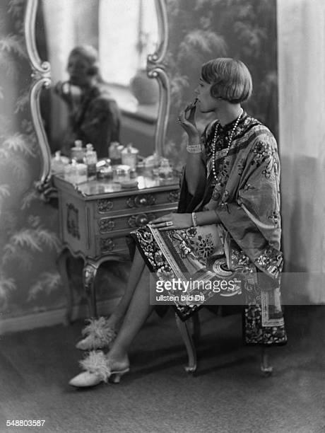 Heel Ellen Actress fullfigure portrait Series From morning until midnight in kimono dressing gown putting on lipstick 1925 Photographer Atelier...