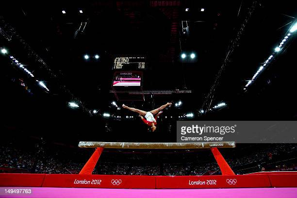 Heem Wei Lim of Singapore performs on the beam in the Artistic Gymnastics Women's Team qualification on Day 2 of the London 2012 Olympic Games at...