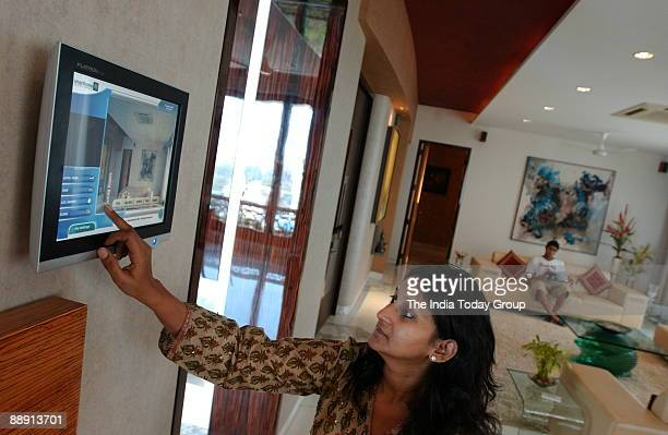 Heena Vora controls her house through touch screen interphase in the Western Indian of City Of Mumbai The touch screen help to switch on and off...