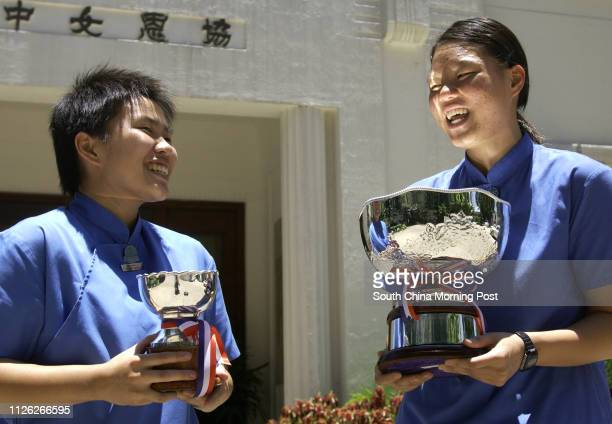 Heep Yunn School's basketball captain Judy To Waiyan and swimming captain Angela Chung Yuenyi holding their trophies after the Prizepresentation...