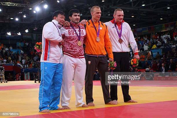 HeeTae Hwang of Korea Tagir Khaibulaev of Russia Henk Grol of Netherlands and Dimitri Peters of Germany with their medals at Excel Arena London as...