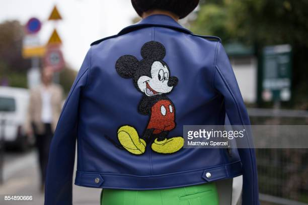 Heewon Kim is seen attending Lanvin during Paris Fashion Week wearing a blue leather Mickey Mouse jacket with green outfit on September 27 2017 in...