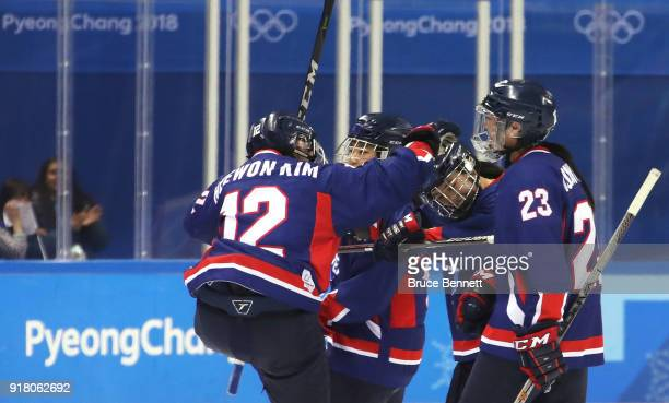 Heewon Kim of Korea celebrates a goal scored by Randi Griffin of Korea in the second period against Japan during the Women's Ice Hockey Preliminary...