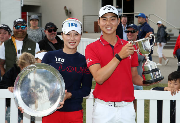 Heeyoung Park of South Korea and Min Woo Lee of Australia pose with their trophies on Day Four after winning the ISPS Handa Vic Open respectively at...
