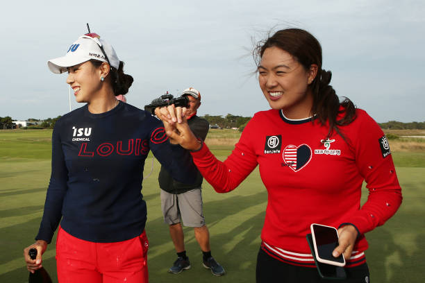 Heeyoung Park of South Korea celebrates winning the ISPS Handa Vic Open with Minjee Lee of Australia on the 18th green at 13th Beach Golf Club on...