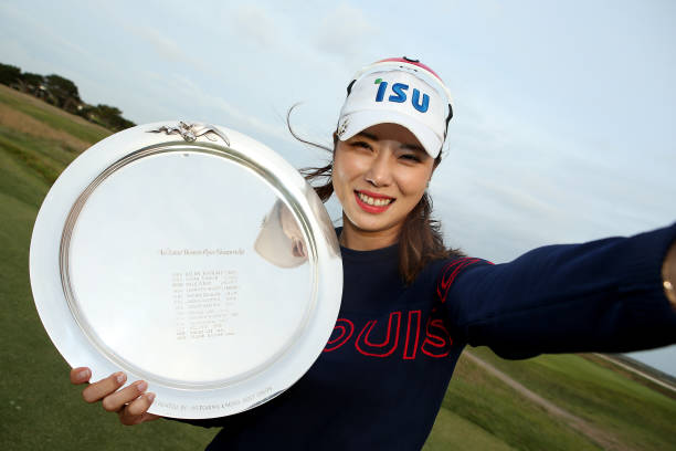 Heeyoung Park of South Korea imitates a 'selfie' as she poses with the Victorian Women's Open Championship trophy after winning the ISPS Handa Vic...