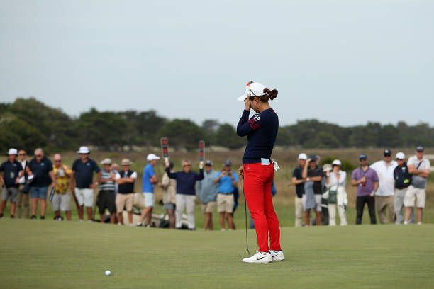 Heeyoung Park of South Korea reacts after missing a putt during the 1st hole playoff on the 18th Beach Course green during Day Four of the ISPS Handa...