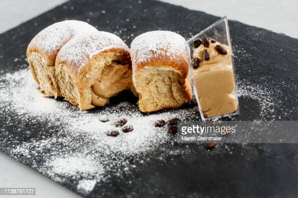 hefegebäck - buchtel gefüllt mit schoko - kaffee - creme - sweet bun stock pictures, royalty-free photos & images