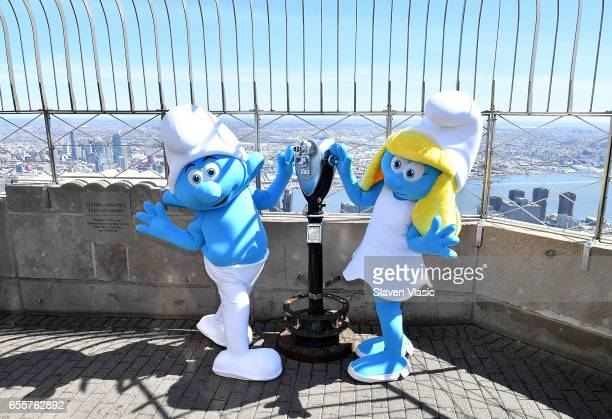 Hefty and Smurfette visit The Empire State Building to celebrate the 'Small Smurfs Big Goals' campaign and the International Day Of Happiness at The...