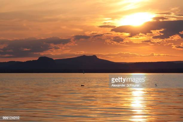 Hegauberge mountains Hohentwiel and Hohenstoffeln, backlit, as seen from the island of Reichenau, administrative district of Constance, Baden-Wuerttemberg, Germany, PublicGround
